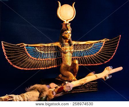 Egyptian Goddess Isis Kneeling With Traditional Magic Wand Made With Quartz, Amethyst Crystals, Wood