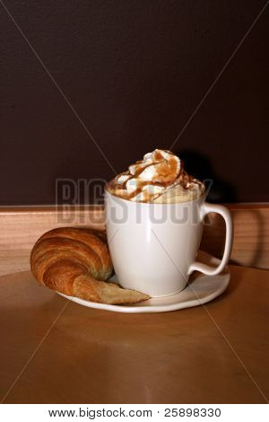 Latte with whipped cream and Caramel and croissant