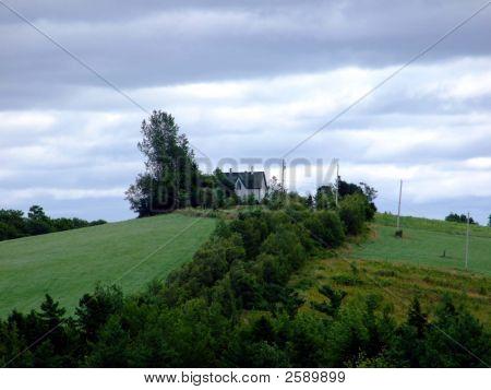 Farm House On A Cloudy Day