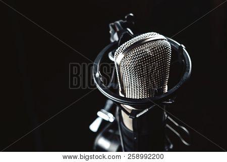 Professional Studio Condenser Microphone On Black Background