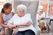 Granddaughter Visiting Grandmother In Retirement Home poster