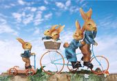 Easter rabbit family on a vacation riding bikes poster