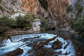 Blagaj Tekke (a Sufi lodge) stands by the source of the Buna river, Bosnia And Herzegovina poster