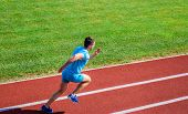Athlete run track grass background. Runner in motion. Many runners like challenge of extending their endurance without having to do training necessary to finish marathon. Man athlete run training poster