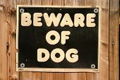 beware of dog sign on a fence poster