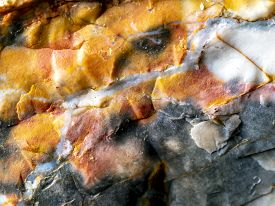 Close Up Of Mineralized Rock With Quartz