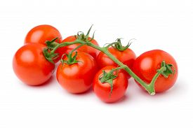 Twig Of Ripe Cherry Tomatoes Isolated On White Background