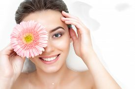 Portrait Of Cute Beauty Female Woman Adult With Clean Pure Skin With Pink Flower Taking Spa Relaxing