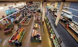 Aerial Elevated View Up Above A Jewel Osco Grocery Store Supermarket With Numerous Rows Of Food, Fre