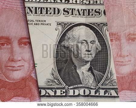 Approach To American One Dollar Bill And Costa Rican Banknotes Of 1000 Colones