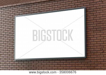 Blank Lightboxe Or Street Lcd Panel On Brown Brick Wall