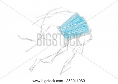 Protective face mask, Typical 3-ply surgical mask to cover the mouth and nose on white background, including clipping path