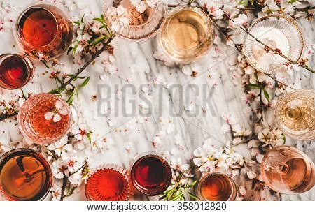 Shades Of Rose Wine Over Marble Background, Copy Space