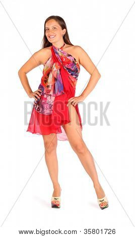 Smiling woman dressed in bright pareo poses in studio on white background.