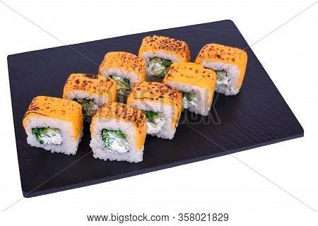 Traditional Fresh Japanese Sushi Rolls On Black Stone Hiashi Cheese On A White Background. Roll Ingr