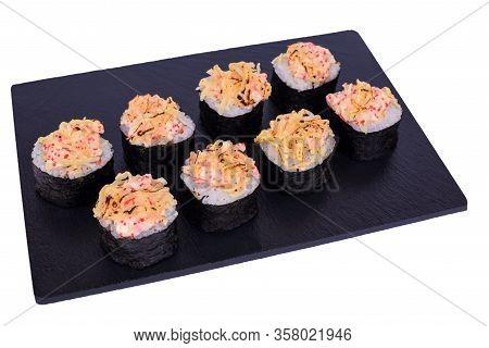 Traditional Fresh Japanese Sushi Rolls On Black Stone Kaji Double Syake Cheese On A White Background