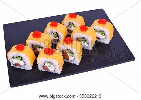 Traditional Fresh Japanese Sushi Rolls On Black Stone Syake Cheese On A White Background. Roll Ingre