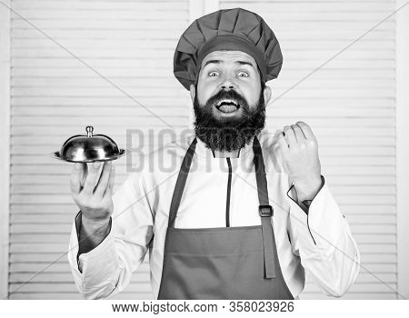Meticulous Preparation And Careful Presentation Meal. Man Hat And Apron Hold Meal Covered With Lid.