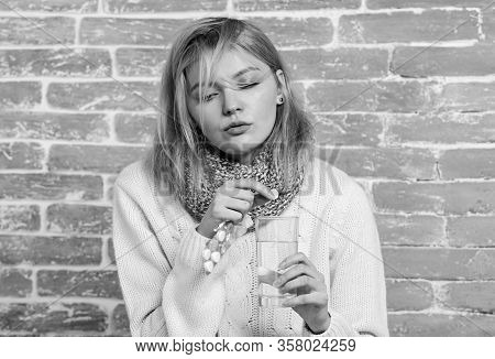 Take Medications To Reduce Fever. Woman Tousled Hair Scarf Hold Glass Water And Tablets Blister. Gir