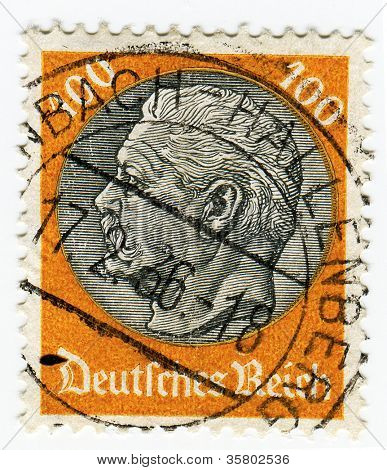 GERMANY - CIRCA 1933: A 100pf stamp printed in Germany   of President Hindenburg in new value, circa 1933
