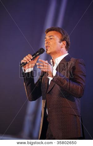 OLHAO, PORTUGAL - AUGUST 8: Tony Carreira  performs onstage at seafood festival on August 8, 2012 in Olhao.