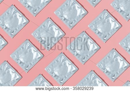 Pattern Of Condoms On A Pink Background. Stay Home Concept. Flat Lay, Top View