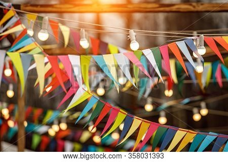 Background From Holiday Flags. Many Colored Flags And Lanterns