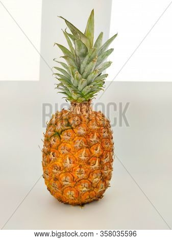 A Whole Pineapple On White. Vegetarian And Healthy Food. Nutrition And Diet Background Stock Photo