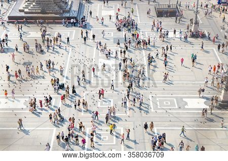 Milan, Italy, September 9, 2018: Crowd Of Small Figures Of Many People Are Walking And A Lot Of Pige