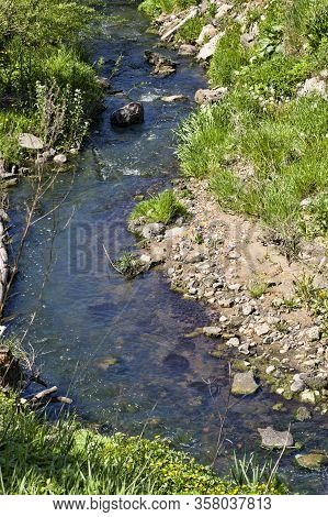Small And Narrow Creek With A Fast Flow Of Water, Part Of The Creek And Its Details
