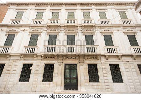 Venice. Italy - May 13, 2019: Facade of Banca Nazionale del Lavoro in Venice. Italy. Old Building.