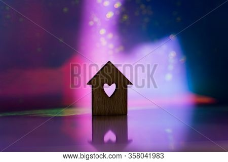 Wooden Icon Of House With Hole In The Form Of Heart On Pink And Purple Dark Galactic Background With