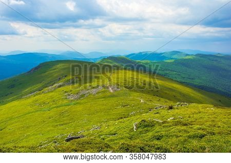 Path Through Mountain Range. Beautiful Alpine Meadows Of Carpathian Landscape On A Cloudy Day In Sum