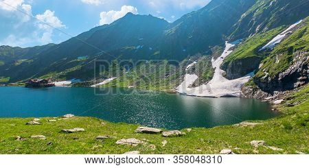Beautiful Nature Of Romania Mountains. Lake Balea In The Valley. Hills Covered In Grass, Rocks And S