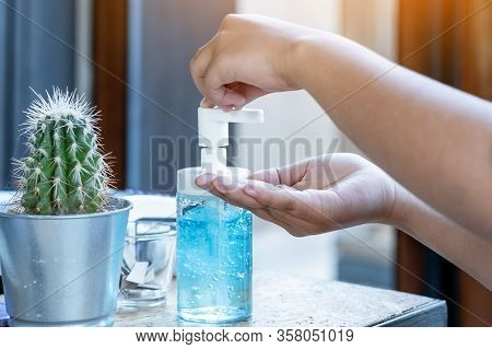 Young Woman Uses Her Hand To Press Hand Sanitizer Bottle To Clean Her Hand. Hand Sanitizer Alcohol G