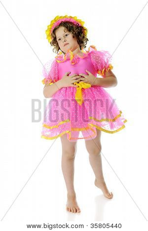 An elementary-aged Shirley Temple impersonator, holding her fully tummy.  On a white background.