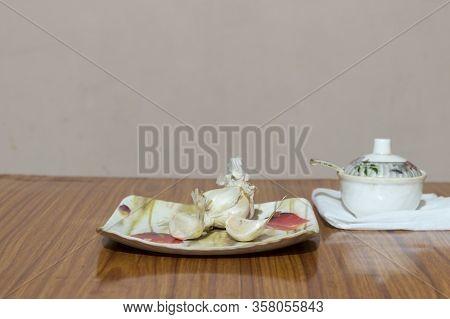 Garlic Salt On Wooden Table. Garlic Salt Is A Seasoned Salt Made Of A Mixture Of Dried, Ground Garli