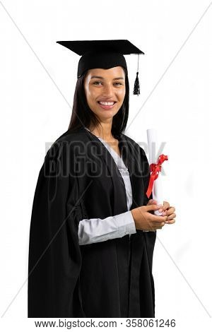 Portrait of a happy mixed race female student wearing a gown and a hat holding a certificate graduating from high school college looking at camera smiling on white background.