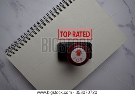 Close Up Red Handle Rubber Stamper And Text Top Rated Isolated On White Background.