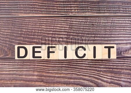 Deficit Word Made With Wood Building Blocks