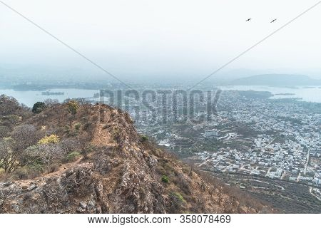 Very Hazy, Polluted Aerial Cityscape View From The Monsoon Palace Of Udaipur, India
