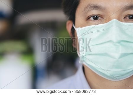 Closeup Man Wearing Hygienic Mask To Prevent Infection.