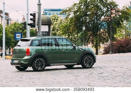 Vilnius, Lithuania - July 6, 2016: Green Color Car Mini Cooper Mini Countryman Is Moving On Street I
