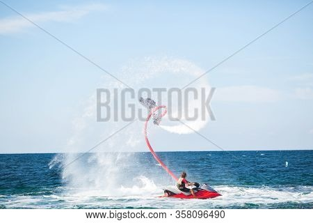 Silhouette Of A Fly Board Rider At Sea.