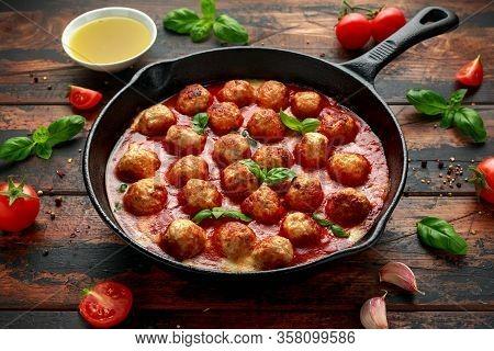 Lean Turkey Breast Meat Balls In Cheesy Tomato Passata Sauce Served In Cast Iron Frying Pan Skillet