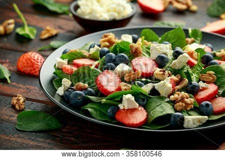 Spinach, Strawberry, Blueberry Salad With Walnut And Feta Cheese. Summer Healthy Food