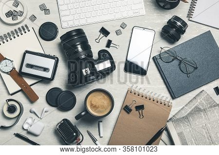 Flat Lay Composition With Equipment For Journalist On Light Table