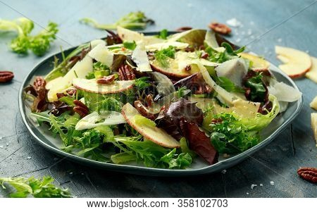 Vegetarian Fennel And Apple Salad With Pecan Nuts And Pecorino Romano Cheese Shavings