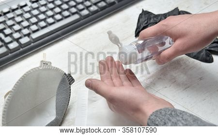 Man Washing His Hands With Hydro Alcoholic Gel At Office