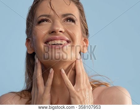 Wash Your Face And Take Care Of Your Skin. Young Woman Washes Her Face And Laughs, Close-up Of Wet C